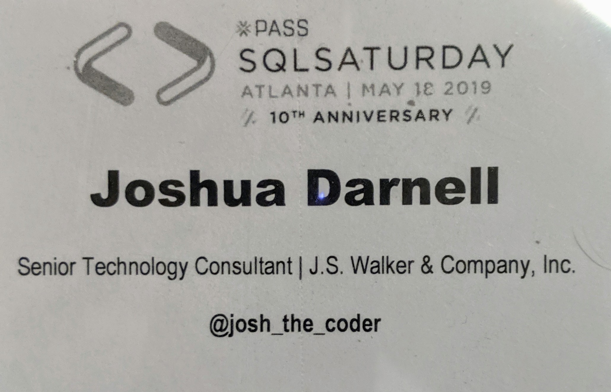 Photo of attendee badge and lanyard